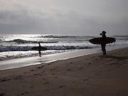 Sri Lanka, Ampara District, Arugam Bay, Pottuvil a small fishing village and popular surfing resort Surfers on the beach