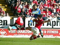 Photo: Scott Heavey<br />Charlton Athletic V Leeds Utd. 05/04/03<br />The attempts of Mark Fish of Charlton do nothing to prevent Mark Viduka making it 0-3 during this FA Barclaycard Premiership match.