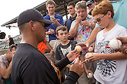 New York Yankees Alex Rodriguez signs autographs before appearing in the first game since hip surgery with the minor league Charleston RiverDogs at Joseph P. Riley Jr. Stadium July 2, 2013 in Charleston, South Carolina.
