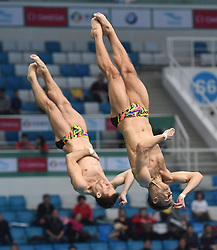 March 9, 2018 - Beijing, China - Ukraine's OLEKSANDR GORSHKOVOZOV (R) and OLEG KOLODIY compete during the Men's 3m Synchronised final at the FINA Diving World Series 2018 in Beijing, China. Oleksandr Gorshkovozov/Oleg Kolodiy took third place with 406.89 points. (Credit Image: © Jia Yuchen/Xinhua via ZUMA Wire)