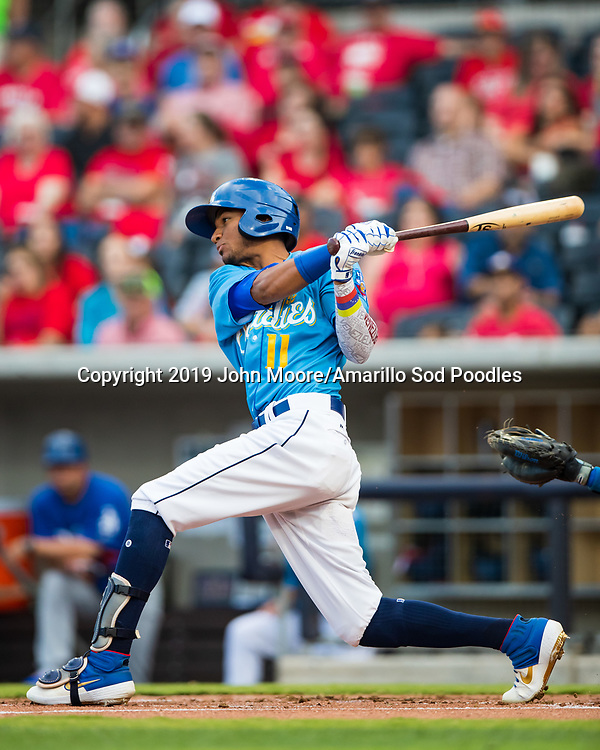Amarillo Sod Poodles outfielder Edward Olivares (11) hits the ball against the Tulsa Drillers during the Texas League Championship on Tuesday, Sept. 10, 2019, at HODGETOWN in Amarillo, Texas. [Photo by John Moore/Amarillo Sod Poodles]