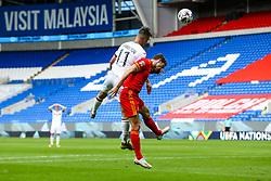 Yanis Karabelyov of Bulgaria is challenged by Ben Davies of Wales - Rogan/JMP - 06/09/2020 - FOOTBALL - Cardiff City Stadium - Cardiff, Wales - Wales v Bulgaria - UEFA Nations League Group B4.