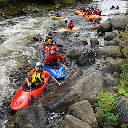 Whitewater kayaking Split-Hair rapid on the Deerfield River in Rowe, Massachusetts. Dryway run.