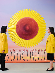 "© Licensed to London News Pictures. 25/09/2019. LONDON, UK. Staff members pose with ""Flower Nipple Colza Yellow"", 2019, by Sarra Badel at the preview of START, a contemporary art fair comprising eclectic works from a variety of international emerging artists.  The fair takes place at the Saatchi Gallery in Chelsea 26 to 29 September 2019.  Photo credit: Stephen Chung/LNP"