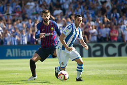 September 15, 2018 - Juanmi of Real Sociedad and Pique of FC Barcelona in action during the match played in Anoeta Stadium between Real Sociead and FC Barcelona in San Sebastian, Spain, at Sept. 15th 2018. Photo UGS/AFP7 (Credit Image: © AFP7 via ZUMA Wire)