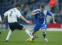Photo: Aidan Ellis.<br /> Preston NE v Cardiff City. Coca Cola Championship.<br /> 19/11/2005.<br /> Cardiff's Jason Koumas fails to get past Preston's Graham Alexander