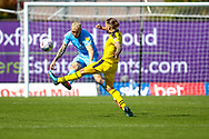 Oxford United midfielder Ricky Holmes (12)  challengers Coventry City defender Jack Grimmer (2) during the EFL Sky Bet League 1 match between Oxford United and Coventry City at the Kassam Stadium, Oxford, England on 9 September 2018.