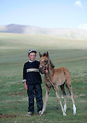 Puckering up to hyenas, cuddling pythons and caressing camels... these images show just how crazy the world is about animals<br /> <br /> An intrepid photographer has scoured the planet snapping people and their pets.<br /> French photographer Eric Lafforgue, travelled everywhere from Easter Island to North Korea to capture on camera mankind's love for animals.<br /> Taken over a period of ten years, each picture gives the viewer a glimpse into the types of pets people choose to own and the relationships they forge with them.<br /> <br /> <br /> Eric Lafforgue spent a decade, from 2005 to 2015, taking photographs of people communing with animals  He ventured as far afield as Ethiopia, Benin, Saudi Arabia, Panama, North Korea, Myanmar and Kyrgyzstan <br /> Among the most astonishing photographs is a man holding meat in his mouth and feeding a hyena  The Frenchman said: 'It is a great lesson of life, you need to take care of the animal to survive'<br /> <br /> Photo shows: Boy Holding A Colt By The Bridle, Jaman Echki Jailoo Village, Song Kol Lake Area, Kyrgyzstan