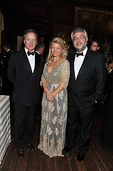 Left to right, HUGO SWIRE MP, his sister SOPHIA SWIRE, and ROBERT BENSOUSSAN at a dinner in aid of Caring For Courage - The Royal Scots Dragoon Guards Afghanistan Welfare Appeal held at The Royal Hospital Chelsea, London SW3 on 20th October 2011.
