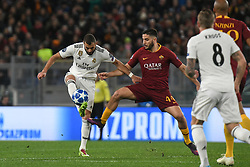 November 27, 2018 - Rome, Italy - Kostas Manolas of AS Roma competes for the ball with Karim Benzema of Real Madrid during the Champions league football match between AS Roma  and Real Madrid at Olimpico stadium in Rome, Italy, on November 27, 2018. (Credit Image: © Federica Roselli/NurPhoto via ZUMA Press)