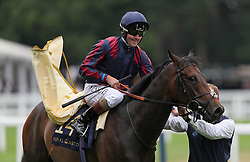 The Tin Man ridden by Tom Queally celebrates winning the Diamond Jubilee Stakes during day five of Royal Ascot at Ascot Racecourse.
