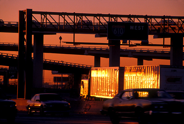 Vehicles on the freeway under the  loop 610 interchange in Houston Texas at dusk