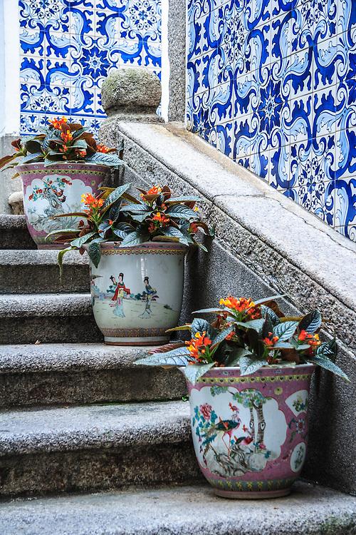 Flower pots on the staircase of Leal Senado in Macau.