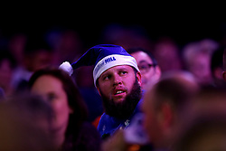 Golfer Andrew Johnston watches Phil Taylor play during day ten of the William Hill World Darts Championship at Alexandra Palace, London.