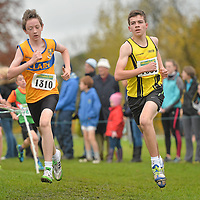 17 November 2013; Donal Devane, Co. Clare, Munster, left, and Sean Corry, Omagh Harriers A.C, Co. Tyrone, Ulster, competing in the Boys U14's race at the 2013 Woodie's DIY Inter County & Juvenile Even Age Cross Country Championships of Ireland. Santry Demesne, Santry, Co. Dublin. Picture credit: Ramsey Cardy / SPORTSFILE *** NO REPRODUCTION FEE ***