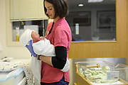 A newborn gets his first bath at St. John's Medical Center in April, 2013.
