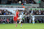 Swansea city's Wilfried Bony ® is challenged by Southampton's Jose Fonte. Barclays Premier league match, Swansea city v Southampton at the Liberty stadium in Swansea, South Wales on Saturday 3rd May 2014.<br /> pic by Andrew Orchard, Andrew Orchard sports photography.