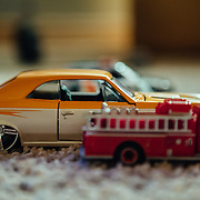 Focusing on a Chevelle resto-mod toy car on the carpet.