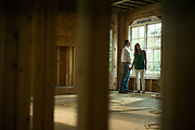 SEPTEMBER 13, 2016: A homeowner and his family survey progress on a new home construction.