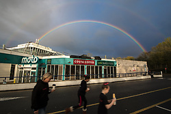 © Licensed to London News Pictures . 15/04/2018 . Staffordshire , UK . A double rainbow seen over a Moto Hilton Park M6 service station in Essington , this evening as a mixture of sunshine and showers ushers in the start of Spring in the UK . Photo credit: Joel Goodman/LNP
