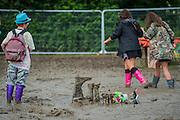 Mud, the wellingtons graveyard - The 2016 Glastonbury Festival, Worthy Farm, Glastonbury.