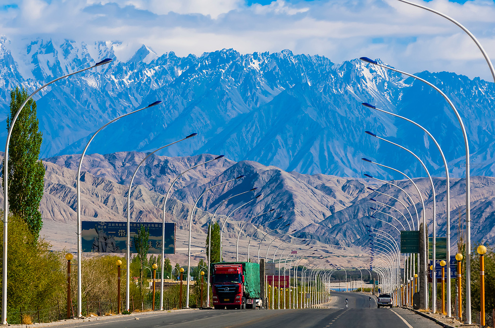 Tashkurgan (means Stone Fortress in Uyghur), at 10,100 feet, along the Karakoram Highway. It was a caravan stop on the Silk Road and all routes of the Silk Road converged here to journey southward to Pakistan. It sits on the borders of both Afghanistan and Tajikistan, and is close to the border of Kyrgyzstan and Pakistan.  The majority population in the town are ethnic Mountain Tajiks. Xinjiang Province, China.