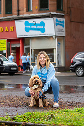Founder Louise Russell with her dog Cooper, at The Give A Dog A Bone charity in Shawlands.