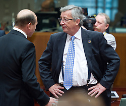 Traian Basescu, Romania's president, left, speaks with Jean-Claude Juncker, Luxembourg's prime minister, during the European Summit meeting at EU Council headquarters in Brussels, Belgium, on Thursday, June 17, 2010. (Photo © Jock Fistick)
