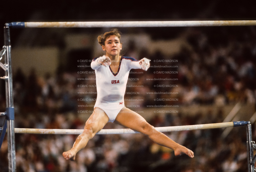 PHOENIX - APRIL 24:  Doe Yamashiro of the United States performs in the uneven bars event during a USA - USSR gymnastics meet on April 24, 1988  at the Arizona Veterans Memorial Coliseum in Phoenix, Arizona.  (Photo by David Madison/Getty Images)