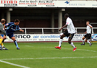 Photo: Mark Stephenson.<br /> Hereford United v Brentford. Coca Cola League 2. 06/10/2007.Hereford's Luke Webb (R) fires the ball in the goal for 2-0