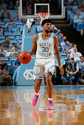 CHAPEL HILL, NC - FEBRUARY 05: K.J. Smith #30 of the North Carolina Tar Heels dribbles the ball during a game against the North Carolina State Wolfpack on February 05, 2019 at the Dean Smith Center in Chapel Hill, North Carolina. North Carolina won 113-96. North Carolina wore retro uniforms to honor the 50th anniversary of the 1967-69 team. (Photo by Peyton Williams/UNC/Getty Images) *** Local Caption *** K.J. Smith