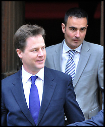 Deputy Prime Minister Nick Clegg leaves the Leveson Inquiry at the High Court, London,with his Chief of Staff Jonny Oates  after giving evidence. Wednesday June 13, 2012.Photo by Andrew Parsons/i-Images..All Rights Reserved ©Andrew Parsons/i-Images .See Special Instructions
