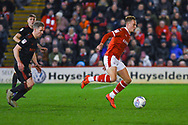 Cauley Woodrow of Barnsley (9) and Grant Leadbitter of Sunderland (23) in action during the EFL Sky Bet League 1 match between Barnsley and Sunderland at Oakwell, Barnsley, England on 12 March 2019.