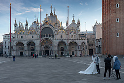 A general view of a wedding couple having their photo taken in St Mark's Square at sunrise in Venice. From a series of travel photos in Italy. Photo date: Tuesday, February 12, 2019. Photo credit should read: Richard Gray/EMPICS