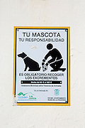 Notice for dog owners to clear up after their pets in Vejer de la Frontera, Cadiz province, Spain