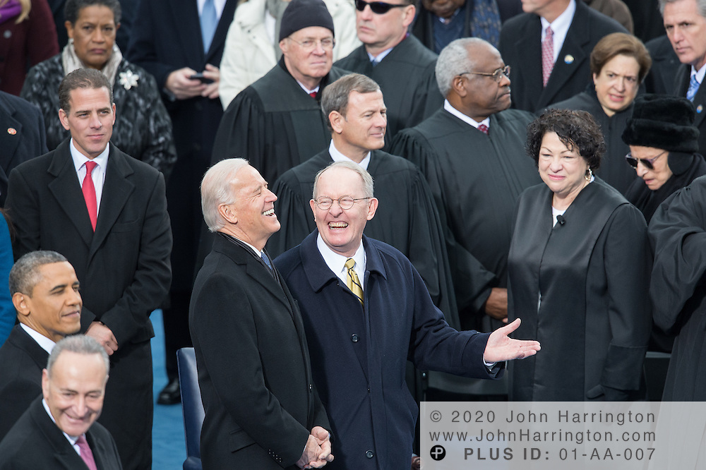 Vice President Biden ant Sen. Lamar Alexander talk as Chief Justice John Roberts, Justice Anthony Kennedy, Justice Clarence Thomas, Jutice Sonya Sotamayor, Jutice Elena Kagen, and Justice Ruther Bader Ginsberg look on, at the 57th Presidential Inauguration of President Barack Obama at the U.S. Capitol Building in Washington, DC January 21, 2013.