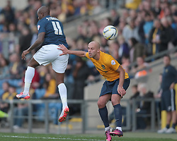 Southend United's Anthony Straker and Oxford United's David Hunt in action - Photo mandatory by-line: Nigel Pitts-Drake/JMP - Tel: Mobile: 07966 386802 05/10/2013 - SPORT - FOOTBALL - Kassam Stadium - Oxford - Oxford United v Southend United - Sky Bet League 2