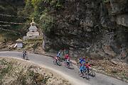 Bhutan, bicycle touring. Stupa below the Dochu La pass.