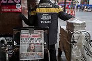 A vendor working for the London Evening Standard newspapers unloads a bundle of copies with a headline about the latest on the rapid spread of the Chinese-source killer Coronavirus on their front pages, at Victoria station, on 30th January 2020, in London, England.