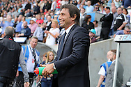 Antonio Conte, the Chelsea manager squeezes a drinks bottle as he looks on from the dugout ahead of k/o.Premier league match, Swansea city v Chelsea at the Liberty Stadium in Swansea, South Wales on Sunday 11th Sept 2016.<br /> pic by  Andrew Orchard, Andrew Orchard sports photography.