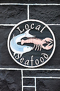 Local Seafood sign at the Plockton Hotel and restaurant in the Highlands of Scotland
