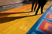 Londoners walk across a multicoloured pedestrianised traffic-free street in the City of London, capitals financial district, aka The Square Mile, on 20th October 2021, in London, England.