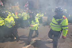 © Licensed to London News Pictures . 03/06/2017 . Liverpool , UK . Smoke bombs are thrown at the EDL marchers . Hundreds of police manage a demonstration by the far-right street protest movement , the English Defence League ( EDL ) and an demonstration by opposing anti-fascists , including Unite Against Fascism ( UAF ) . Photo credit: Joel Goodman/LNP