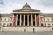 A lone piper plays to an empty square in front of the National Gallery in Trafalgar Square in London on March 20th, 2020. The centre of London is extremely quiet after the numbers of tourists has plummeted and locals limit their activities due to the Coronavirus crisis.