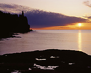 Split Rock Lighthouse silhouetted as the sun rises over Lake Superior, Split Rock Lighthouse State Park, Minnesota.