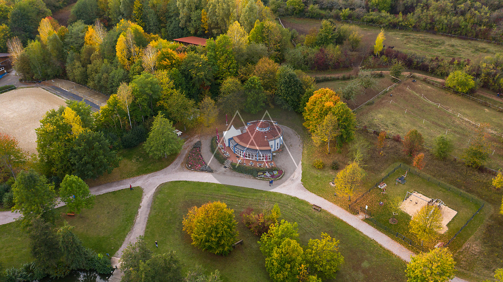 Aerial view of a park with closed café, in autumn, pandemic, Germany.