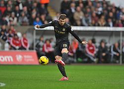 Manchester City's Edin Džeko shoots at goal. - Photo mandatory by-line: Alex James/JMP - Tel: Mobile: 07966 386802 01/01/2014 - SPORT - FOOTBALL - Liberty Stadium - Swansea - Swansea City v Manchester City - Barclays Premier League