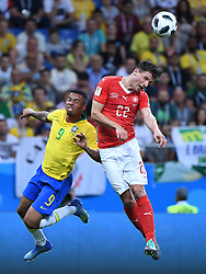 ROSTOV-ON-DON, June 17, 2018  Gabriel Jesus (L) of Brazil competes for a header with Fabian Schaer of Switzerland during a group E match between Brazil and Switzerland at the 2018 FIFA World Cup in Rostov-on-Don, Russia, June 17, 2018. (Credit Image: © Li Ga/Xinhua via ZUMA Wire)