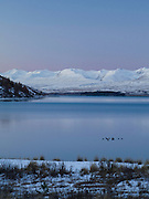 Sunset falls over Lake Tekapo, New Zealand, with the Two Thumbs Range in the background.
