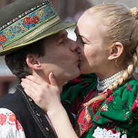 Man and woman wearing traditional dresses of the Matyo people share a kiss during the Easter watering celebration in Mezokovesd (about 130 km East of capital city Budapest), Hungary on April 13, 2017. ATTILA VOLGYI